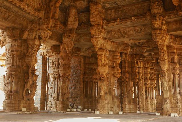pillars inside of vijaya vittala temple in hampi