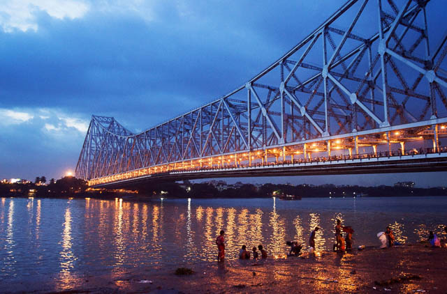 reflection of Howrah Bridge lights on Hoogly river in Kolkata, West Bengal