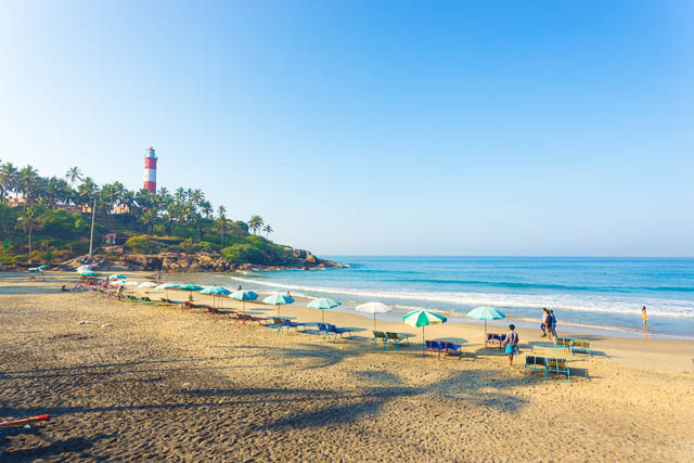 beach chairs in view of ocean waves at kovalam light house beach, kerala