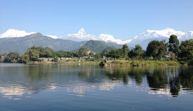 himalayas can be seen from phewa lake in pokhara, nepal