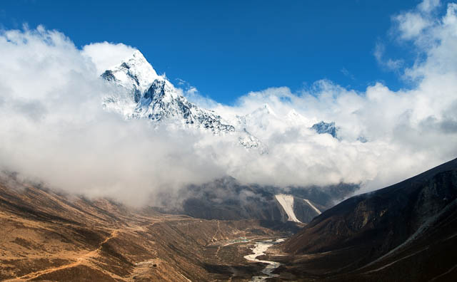 mount ama dablam within clouds, a way to everest base camp, khumbu valley, nepal