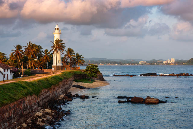 amazing sunset near galle fort lighthouse in the bay of galle, sri lanka