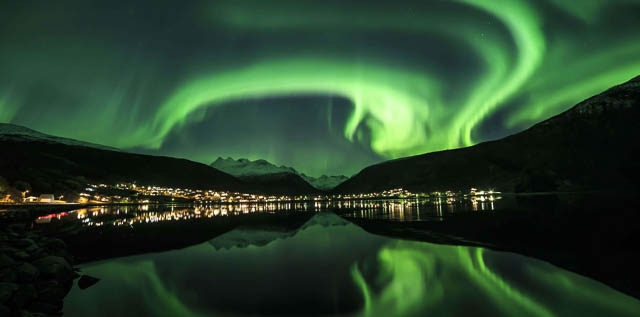 reflection of northern lights on a waterbody in narvik, norway