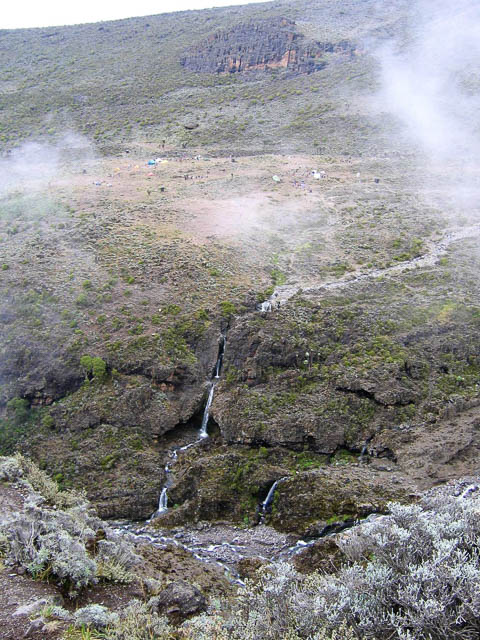 small stream on barranco wall cliff in tanzania