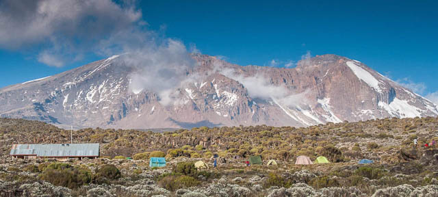 camping tents on mweka camp on machame route while climbing on mount killimanjaro, tanzania