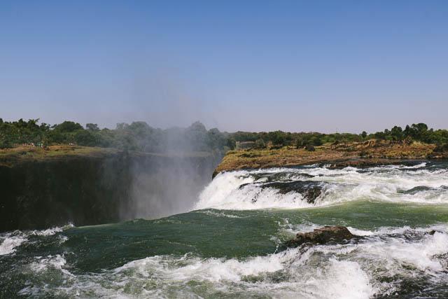 the edge of victoria falls in zimbabwe, near livingstone island