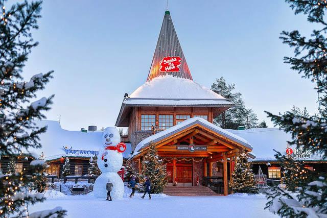snowman infront of santa claus office in santa claus village rovaniemi finland
