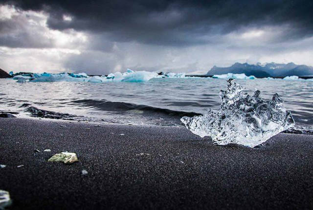 ice rocks on black sand beach at jokulsarlon iceland