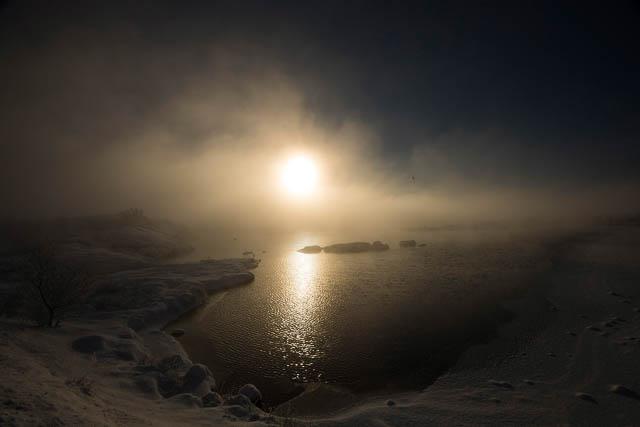 the fog near water body covered the sun in thingvellir national park