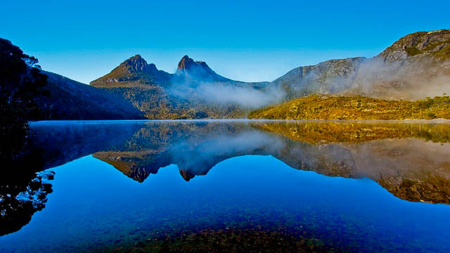 cradle mountain with a lake beneth it