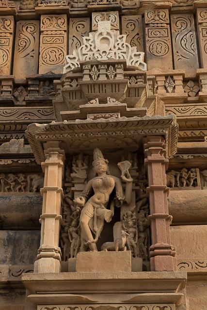 statue carved at temple wall at Khajuraho India
