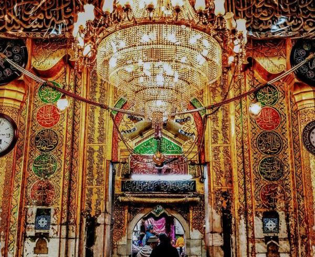 a bright chandelier being lit up amidst beautiful interior inside a mosque in Ajmer Rajasthan India