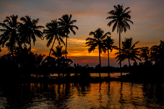 golden sky across backwaters in Alappuzha Kerala India
