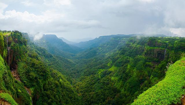 small waterfalls amidst clouds in amboli hill maharashtra india