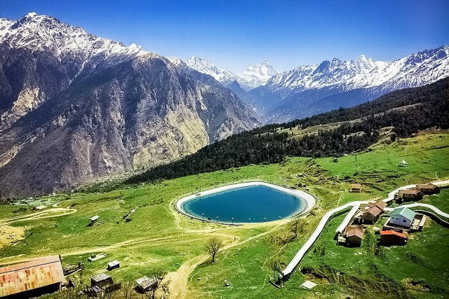 snow capped mountains and aerial views of chenab lake in auli uttarakhand india